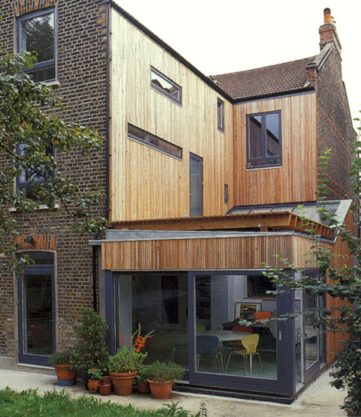 Larch clad breathing wall system with Danish timber windows.